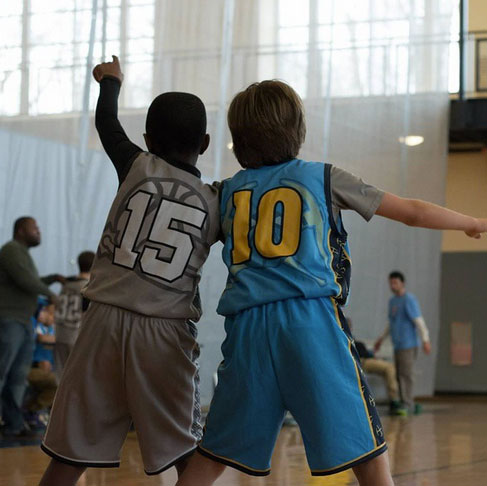 Youth Playing in Custom Basketball Uniforms
